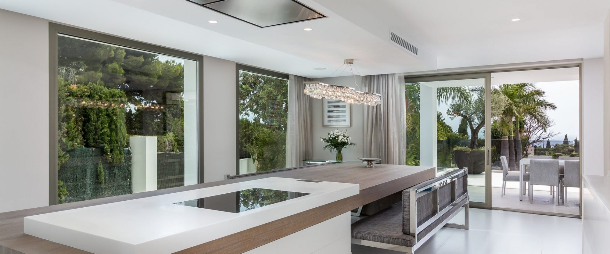 marbella's 1st solid krion and gaggenhau professional kitchen with 5.5m oak family table